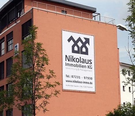 Druck und Montage Gebäude Werbung